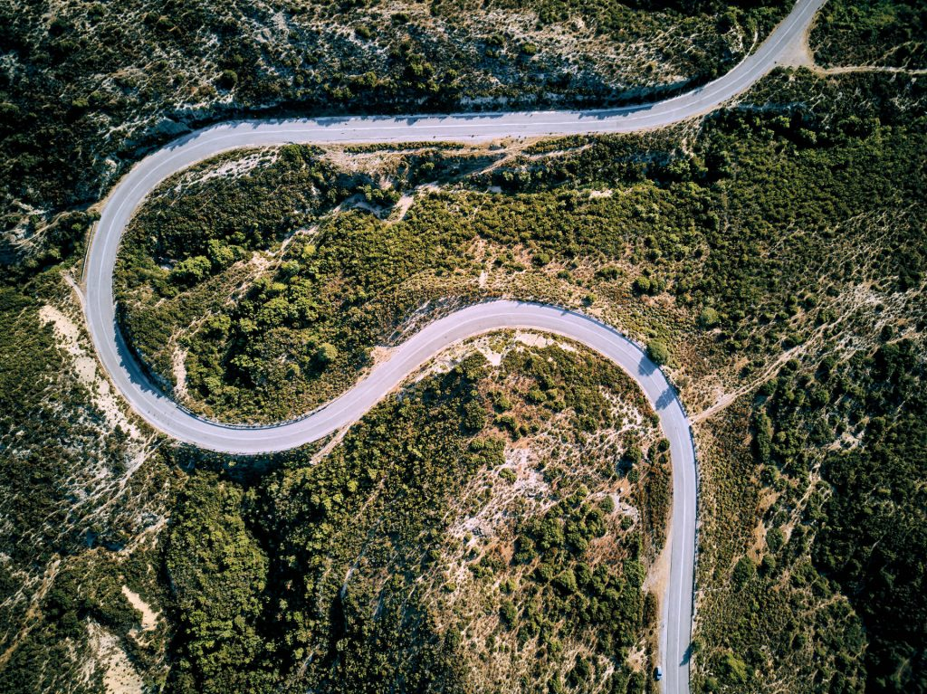 winding-road-aerial-view-Q7KNLYM