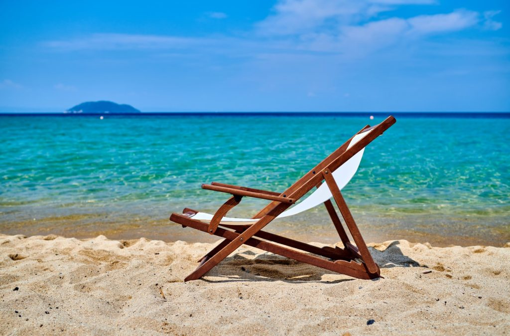 Beautiful beach with lounger chair in Sithonia, Greece